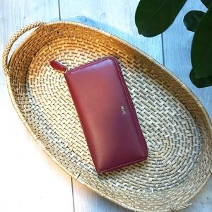 JW PEI red faux leather zip-around wallet